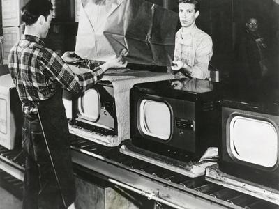 https://imgc.allpostersimages.com/img/posters/at-the-end-of-the-assembly-line-inspected-televisions-are-packaged-in-an-american-factory_u-L-Q10WVHY0.jpg?p=0