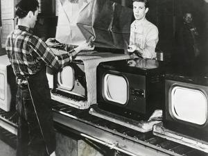 At the End of the Assembly Line, Inspected Televisions are Packaged in an American Factory
