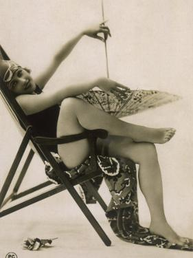 Attractive Woman Posing in Her Swimsuit in a Deckchair, with a Parasol