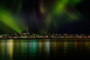 Aurora Borealis or Northern Lights over Reykjavik Skyline, Reykjavik, Iceland