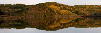 Autumn foliage reflected in a small lake in central Wisconsin, USA