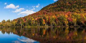 Autumn trees reflection in pond, Sugarloaf Pond, Potton, Quebec, Canada