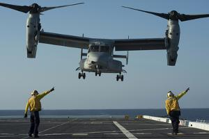 Aviation Boatswain's Mates Direct an MV-22 Osprey as it Launches from the Flight Deck