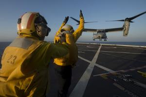 Aviation Boatswain's Mates Direct an MV-22 Osprey on the Flight Deck