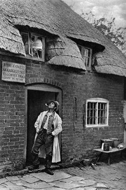 A Man Smoking a Pipe Outside a Shop, Worcestershire, C1922 by AW Cutler
