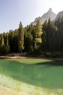 Lake Prags, Prags Dolomites, South Tyrol, Italy: The Lake, Trees And A Mountain Peak In The Sun by Axel Brunst
