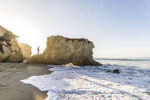 Malibu, California, USA: Man Standing On Rock At Famous El Matador Beach In Summer In Early Morning by Axel Brunst