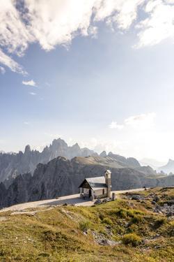 Tre Cime Di Lavaredo (Drei Zinnen), Sexten Dolomites, Italy: Cappella Degli Alpini, Evening Hikers by Axel Brunst