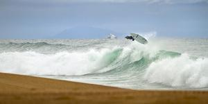 Young French Surfer with a Radical Air in Plage Les Casernes, France by Axel Brunst