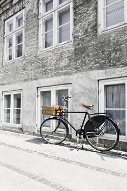 Bicycle Leans Against Wall, City, Copenhagen, Denmark, Scandinavia by Axel Schmies