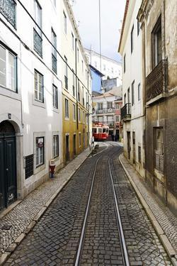 Historical Streetcar in the Alfama District, Lisbon, Portugal by Axel Schmies