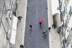 People with Colourful Umbrellas, Vertical View from the Elevador De Santa Justa, Lisbon by Axel Schmies