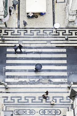 People with Umbrellas, Vertical View from the Elevador De Santa Justa, Lisbon by Axel Schmies