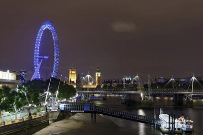 The Thames with London Eye and the Houses of Parliament, at Night, London, England, Uk