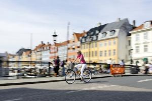 Tourist on Bicycle, Entertainment District, Nyhavn, Copenhagen, Scandinavia by Axel Schmies