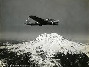 """B-17 """"Flying Fortess"""" Bomber over Mt. Rainier, 1938"""