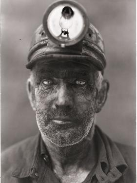 A close-up portrait of a coal miner. by B. Anthony Stewart