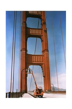 A Man Repairs a Light on the Golden Gate Bridge by B. Anthony Stewart
