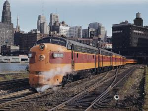 A Train on the Tracks with the Chicago Skyline in the Background by B. Anthony Stewart