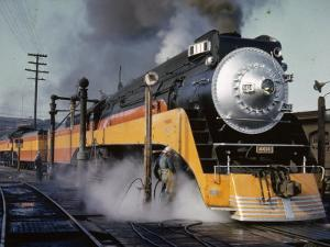 Man Fuels a Steam Locomotive at the Terminal by B. Anthony Stewart