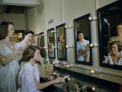 Members of an Opera Chorus Put on Costumes in a Dressing Room by B. Anthony Stewart