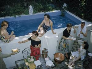 Men and Women Relax Beside a Small Backyard Swimming Pool by B. Anthony Stewart