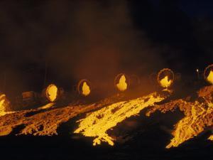 Molten Slag Cascades Down a Hillside at Night by B. Anthony Stewart