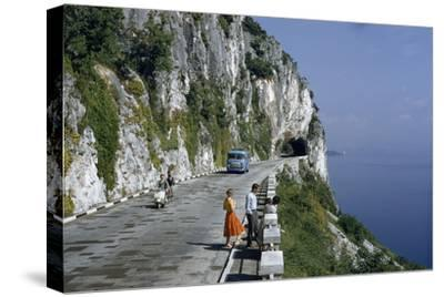 Near Trieste, Italy. Motorists Pass People on a Scenic Road Atop a Cliff Overlooking a Bay by B. Anthony Stewart