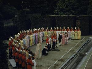 Opera Singers and Chorus Rehearse a Curtain Call on an Outdoor Stage by B. Anthony Stewart