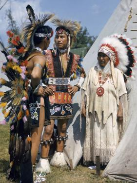 Otoe Indians Wearing Traditional Clothing Stand in Front of a Tipi by B. Anthony Stewart