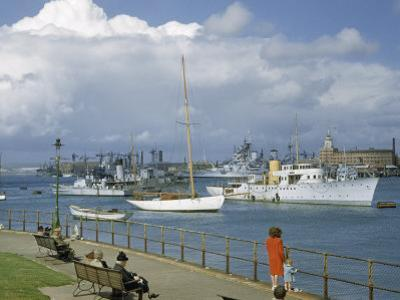 People at Gosport Hard Park Watch Ship Traffic at Naval Dockyards by B. Anthony Stewart