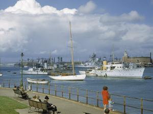 People at Gosport Hard Park Watch Ship Traffic at Naval Dockyards by B. Anthony Stewart