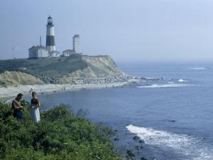 People Stand on Point across Bay from Montauk Point Light by B. Anthony Stewart