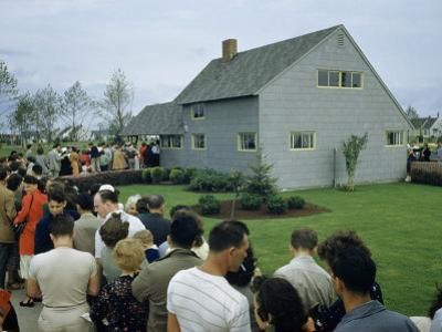People Wait in Line Outside a New Levittown House by B. Anthony Stewart