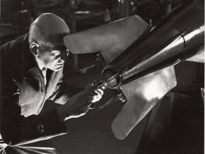 Robert Goddard Adjusting a Steering Vane by B. Anthony Stewart