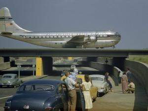 Sightseers Park to Watch a Stratocruiser Taxi across an Underpass by B. Anthony Stewart