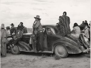 Vintage Image of Native Americans Sitting On an Early Automobile by B.Anthony Stewart