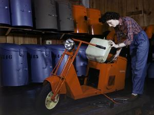 Woman Works on a Cushman Scooter for the War Effort by B. Anthony Stewart
