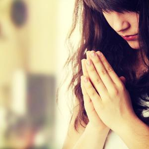 Closeup Portrait of a Young Caucasian Woman Praying by B-D-S