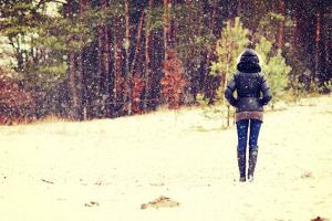 Woman is Standing on Meadow in the Forest Durring Wintertime. by B-D-S