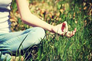 Young Woman during Relaxation and Meditation in Park Meditation Session. Frame Shows Half of Body. by B-D-S