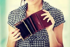 Young Woman Shows Her Empty Wallet. Bankruptcy by B-D-S