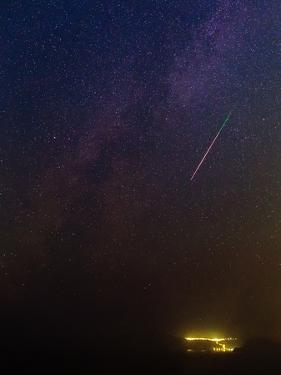 A Bright Meteor During Perseid Meteor Shower Streaks across the Night Sky by Babak Tafreshi