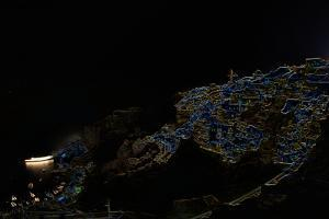 A Color Inverted Composite Image of Santorini Island at Night by Babak Tafreshi
