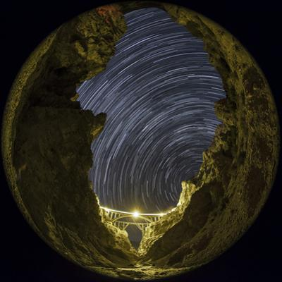 A Long Exposure Fisheye Image Shows the Rotating Sky Above Veresk Bridge by Babak Tafreshi