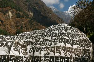 A Mani Stone in the Himalaya, Inscribed with Phrases and Mantras Meant to Keep Travelers Safe by Babak Tafreshi