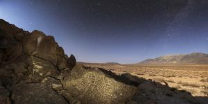 A Moonlit Night Above an Ancient Native American Petroglyph in California by Babak Tafreshi