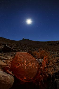 A Moonlit Night over the La Silla Observatory and an Ancient Petroglyph by Babak Tafreshi