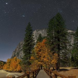 A Moonlit Scenic of a Footbridge on the Merced River, with Planet Jupiter, in Taurus Overhead by Babak Tafreshi