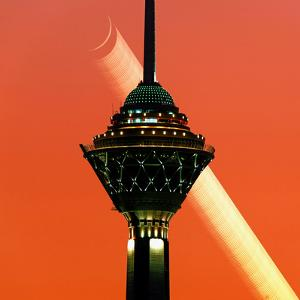 A Multi-Exposure Image of the New Moon Setting in the Evening and the Milad Communication Tower by Babak Tafreshi